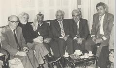 With Arafat and Mahmoud Abbas (right), Tunis, 1989